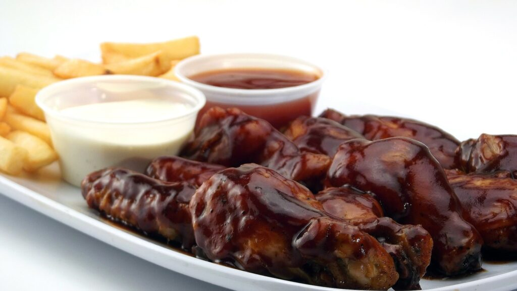 gooey chicken wings with dipping sauces