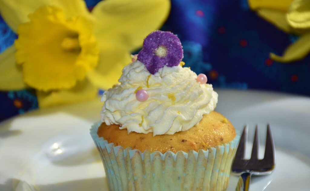 cupcake with frosting and candy decorations